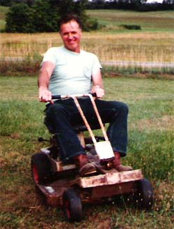 My Dad - Ollie C. Patrick mowing the lawn